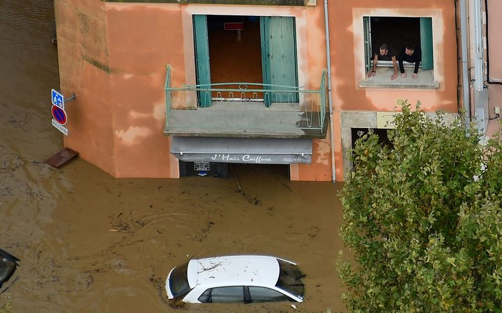 An aerial view taken on October 15, 2018 shows a flooded street in the city of Trèbes