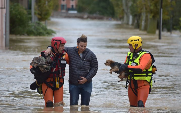 Firefighters helps a resident with a dog