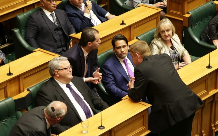 Jami-Lee Ross at Simon Bridges' side during a session in Parliament.