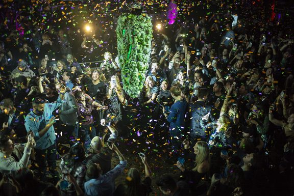 "orontonians gather at a local concert venue to watch the ""bud drop"" at the stroke of midnight, in celebration of the legalization of recreational cannabis."