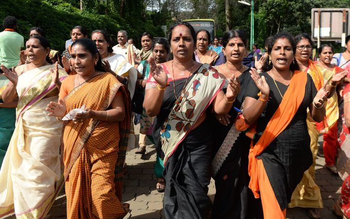 Indian Hindu devotees and activists protesting a Supreme Court verdict revoking a ban on women's entry to Sabarimala's Ayyappa Hindu temple, in Keralal.