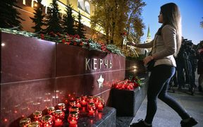 A woman lays flowers at the WWII Hero Cities Memorial to the city of Kerch in downtown Moscow.
