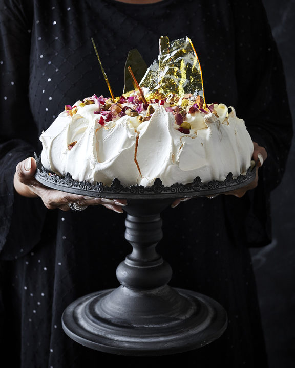 Pavlova with rose cream, cardamom and salted caramel shards
