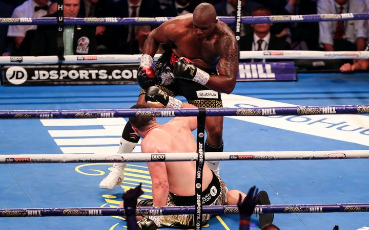 Dillian Whyte floors Joseph Parker during their WBC title fight in London in July.