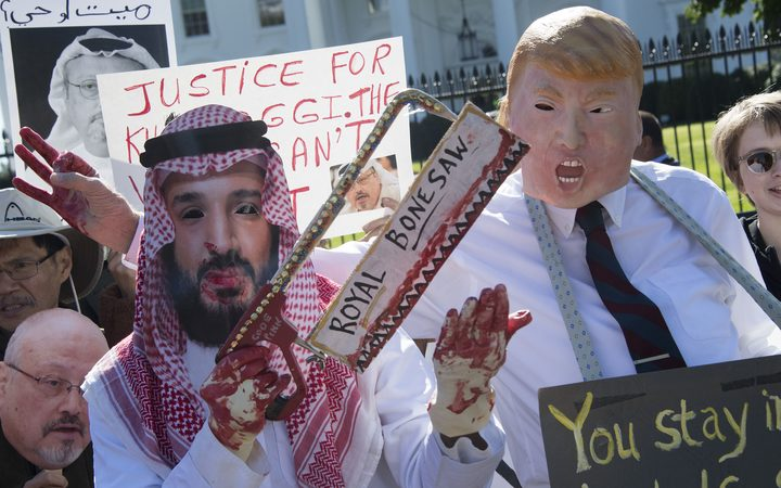 Demonstrators dressed as Saudi Arabian Crown Prince Mohammed bin Salman and US President Donald Trump