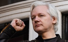 In this file photo taken on May 19, 2017 Wikileaks founder Julian Assange raises his fist prior to addressing the media