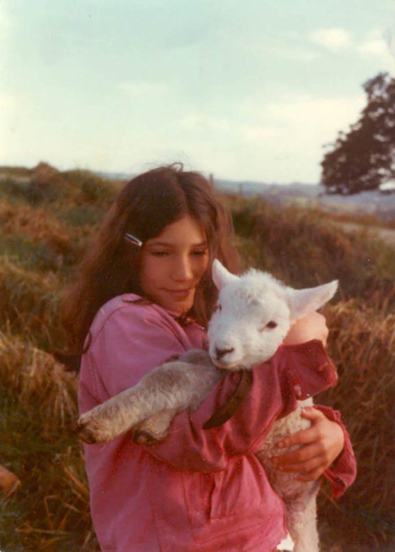An 11-year-old Zoe Helene in New Zealand, with her pet lamb Wai.