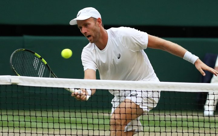 Michael Venus plays a drop shot during the final of the men's doubles at Wimbledon.