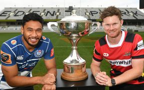 TJ Faiane (Auckland) and Mitchell Drummond (Canterbury) with the Mitre 10 Cup trophy.