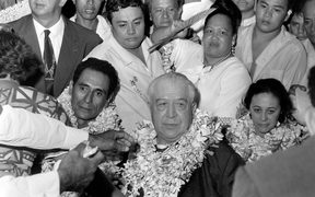 In this file picture taken in Papeete on December 9, 1968 French Polynesia politician and Tahitian nationalist, Pouvanaa A Oopa is greeted with garlands after his return to French Polynesia following his pardon by then President Charles de Gaulle.