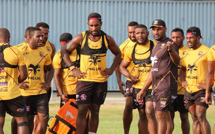PNG coach Michael Marum, (in black), takes his players through their paces