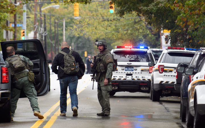 Police rapid response team members respond to the site of a mass shooting at the Tree of Life Synagogue in the Squirrel Hill neighborhood in Pittsburgh, Pennsylvania.