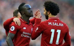 Sadio Mane celebrates his goal with Liverpool teammate Mohamed Salah