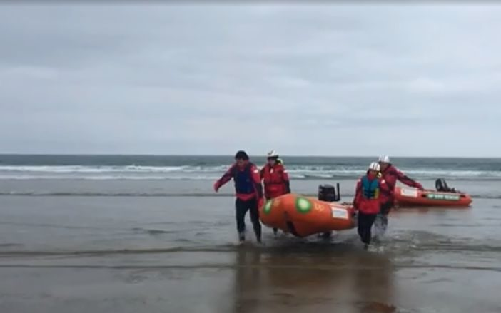 Members of the Otago Surf Life Saving SAR team, of Dunedin, end their day's search.