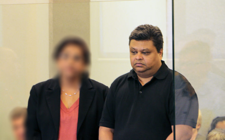 Rohit Deepak Singh standing alongside an interpreter at the High Court in Auckland.