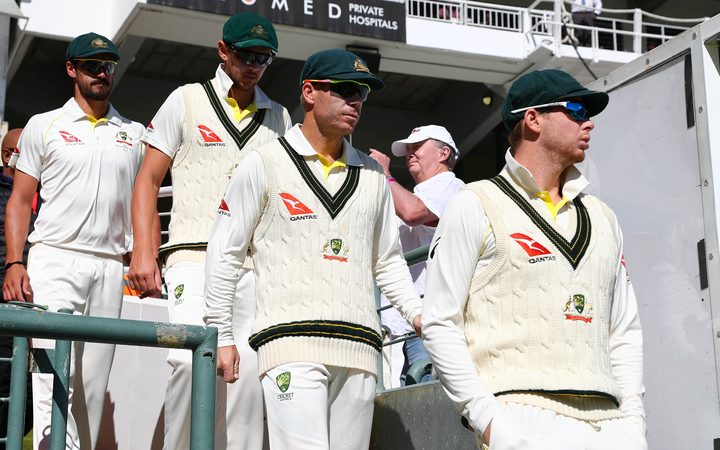 Steve Smith (right) and David Warner (centre) take to the field during Day 4 of the controversial test against South Africa in Capetown.