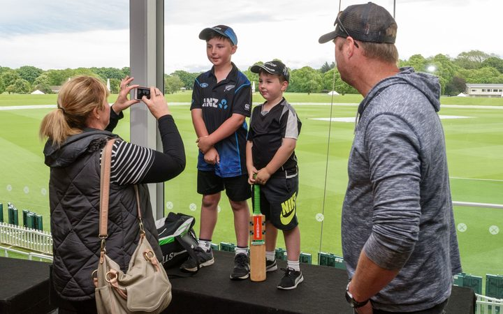 Young Blackcaps fans pose for their parents.