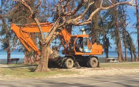 Diggers clear debris in Saipan, post-Yutu