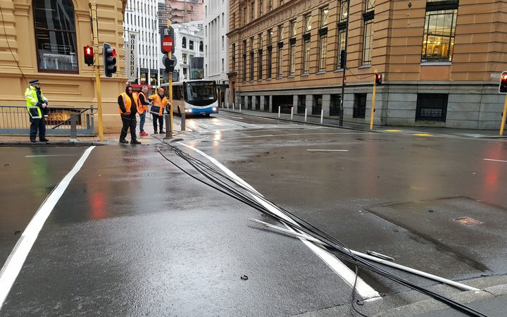 Power lines on the ground at the corner of Hunter Street and Customhouse Quay in central Wellington.