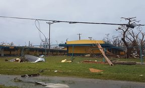 A school building is damaged after Super Typhoon Yutu