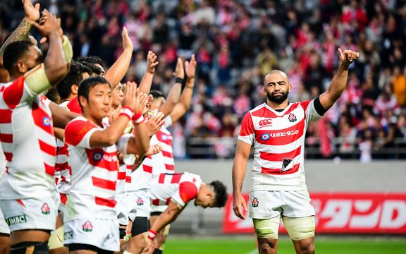 Japan, led by captain Michael Leitch, thank the crowd after the match against All Blacks.
