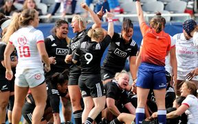 Black Ferns' players celebrate their third try.