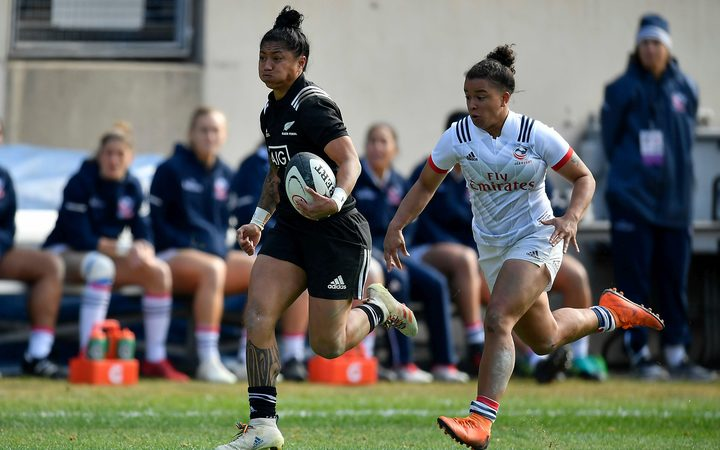 New Zealand Black Ferns right wing Renee Wickliffe chased by USA player.