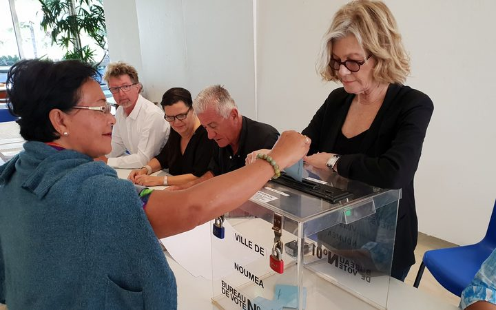 Noumea mayor Sonia Lagarde supervises the casting of the ballot paper to then announce 'voté!'
