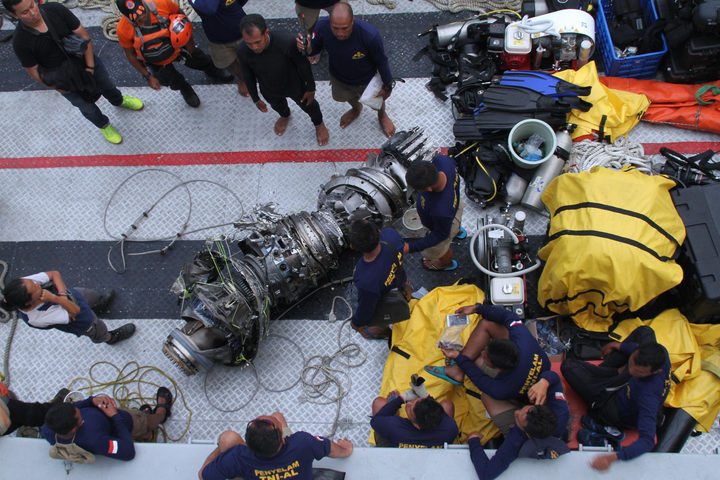 Parts of an engine of the ill-fated Lion Air flight JT 610 are recovered from the sea during search operations in the Java Sea.