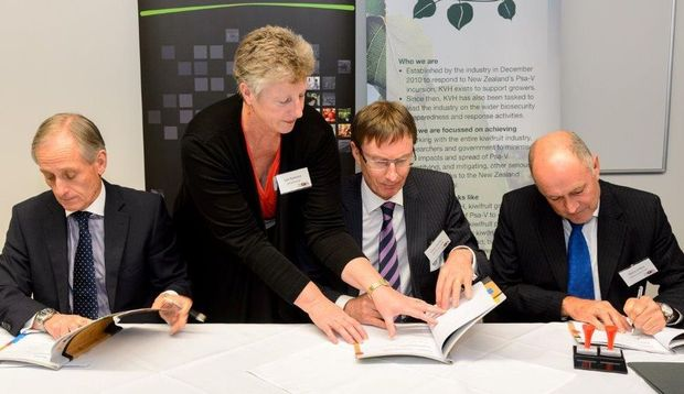 Signing the GIA Deed are (from left): Ministry for Primary Industries director general Martyn Dunne, Government Industry Agreement secretariat manager Lois Ransom, Kiwifruit Vine Health board chair Peter Ombler and Kiwifruit Vine Health chief executive Barry O'Neill.