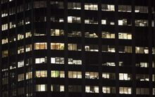 A late night office block with lights on in Auckland's CBD.