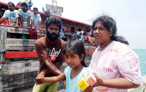 Sri Lankan asylum seekers disembark from their wooden boat in Indonesia.