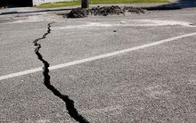 Earthquake damage to Avonside Road in Christchurch.