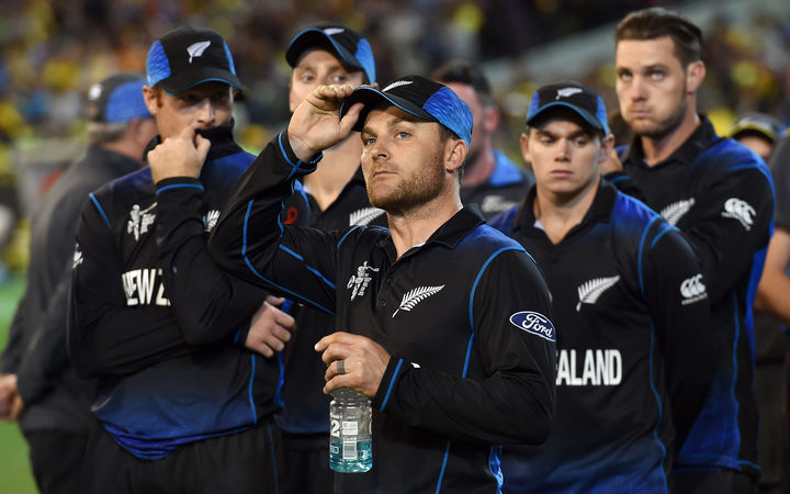 Brendon McCullum stands with his team after their Cricket World Cup final defeat.