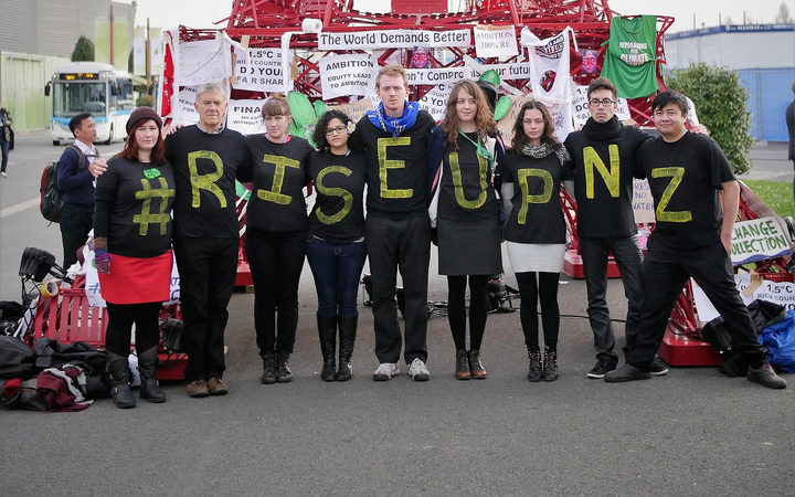New Zealand youth delegates protest as part of the Rise Up campaign at COP21 in Paris.