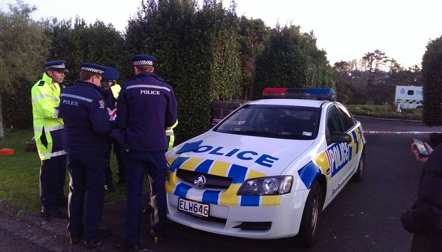 Officers at the entrance to Birkenhead Glenfield cemetery on Tuesday.