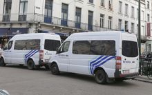Police vans at the Jewish Museum in Brussels after the shooting.