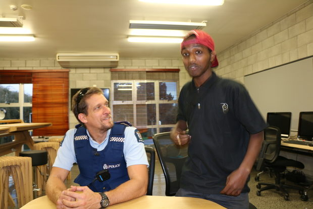 Ethnic Liaison Officer Constable Rob Stanton with Mahad Yusef.