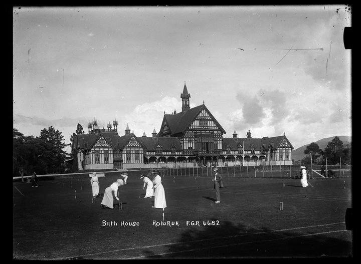 1910: Women playing croquet on the lawn in front of the Rotorua Bath House in the Government Sanitorium Grounds.