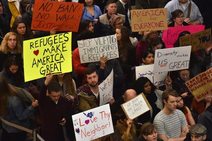 Protesters rally against Trump's seven-country ban at Reagan National Airport in Arlington, Virginia