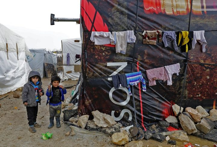 Syrian children at an unofficial refugee camp in the village of Deir Zannoun in Lebanon's Bekaa valley.