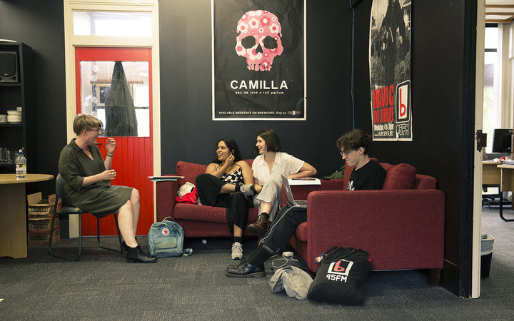 Caitlin McIlhagga (left) chats to volunteers in the bFM station office.