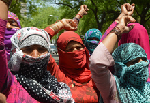 Demonstrating villagers protest in New Delhi against the gang-rape of a lower caste Dalit in nearby Haryana state.