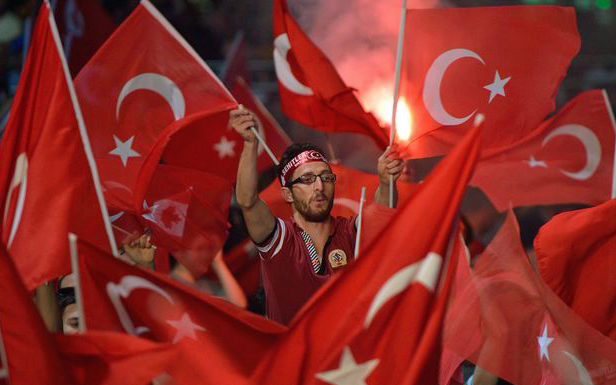 Turkish flags are waved in support of the Turkish president in Taksim Square in 2016.