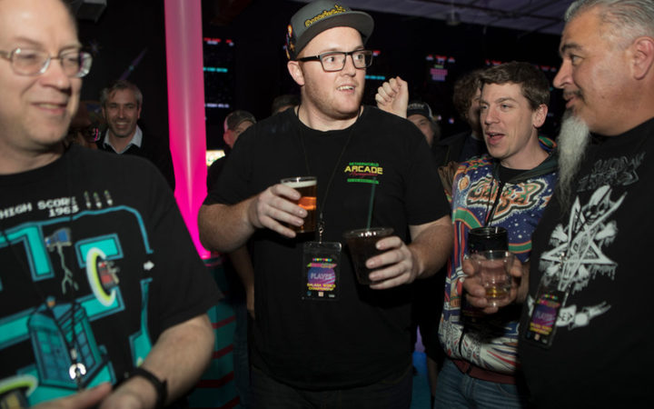 Andrew Barrow shares a beer with his fellow gamers.