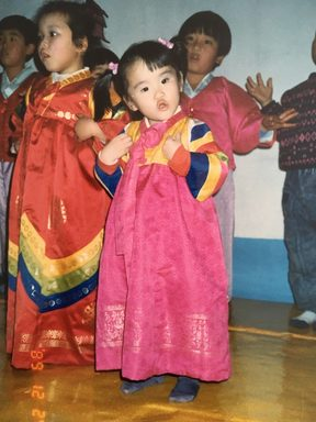 "Maria Mo: ""I was 2 here. Reppin' my hanbok at the Sunday school Christmas show at church. I like to think this was my peak."""