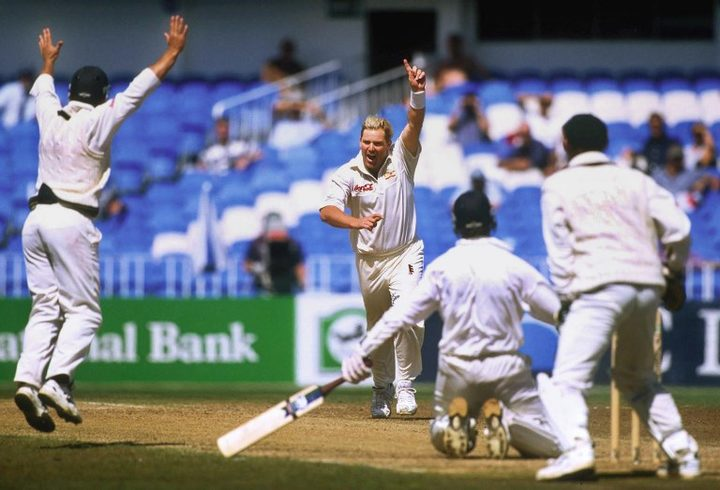 Shane Warne celebrates his test wicket-taking record of 355 on the last day of the first Test match between Australia and New Zealand at Eden Park 15 March 2000.