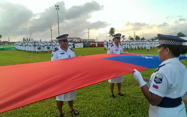 Members of the Samoan Police Force preparing to raise the national flag at Independence Day celebrations in Apia.