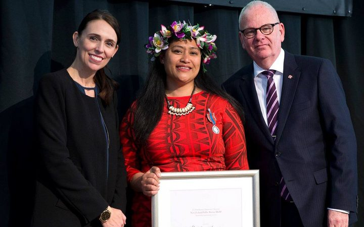 Matalena Leaupepe, (centre), is presented with her Public Service Medal by PM Jacinda Ardern and State Services Commissioner, Peter Hughes