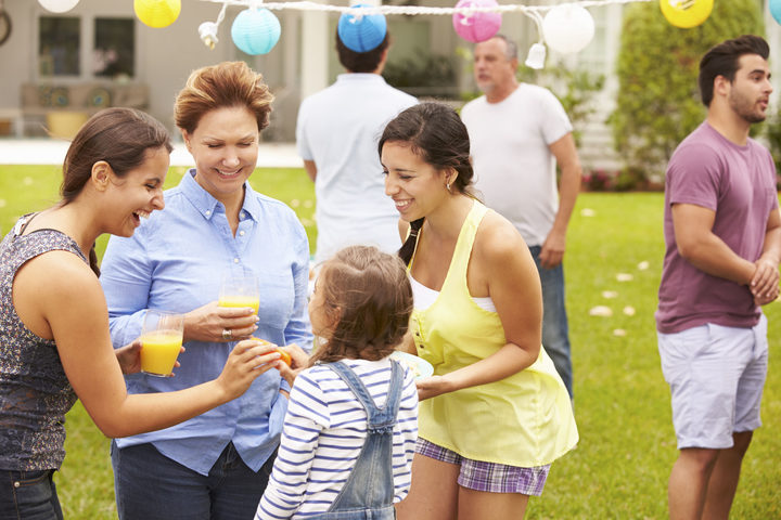 33550343 - multi generation family enjoying party in garden together